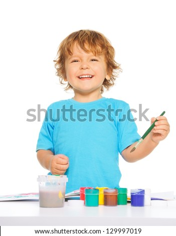 Happy smiling kid painting with paintbrush and colorful vivid colors, smiling, isolated - stock photo