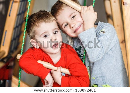 Happy smiling kids two boys looking at camera - stock photo