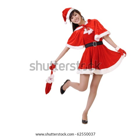 Happy smiling lady of Asian in Santa Claus clothes, full length portrait isolated on white. - stock photo