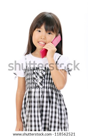 Happy smiling little asian girl calling by cellular phone - stock photo