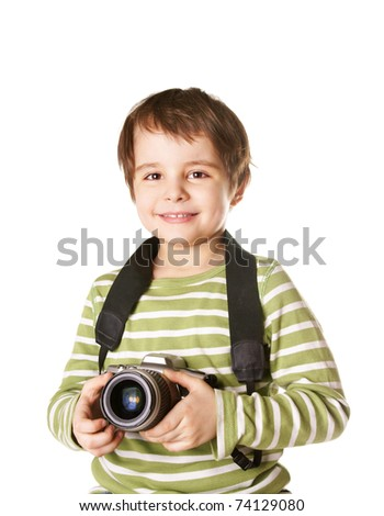 Happy smiling little boy with photocamera isolated on white background - stock photo