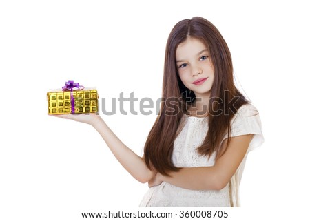 Happy smiling little girl holding and offering a gift for Christmas and birthday isolated on white background - stock photo