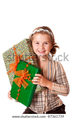 Happy smiling little girl holding gifts for Christmas or birthday isolated on white background