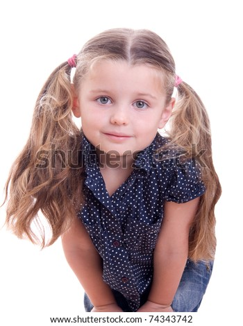 Happy smiling little girl isolated on white background in studio - stock photo