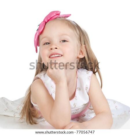 Happy smiling little girl on white background in studio - stock photo