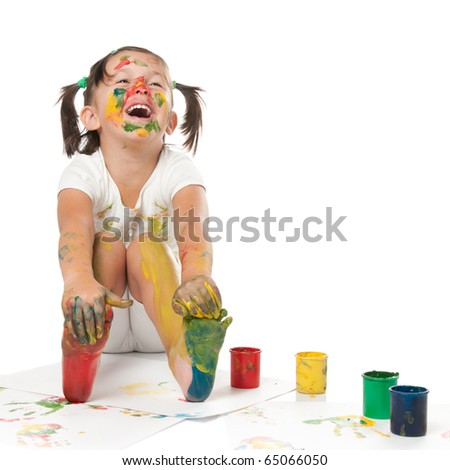 Happy smiling little girl playing and painting with colors isolated on white background - stock photo