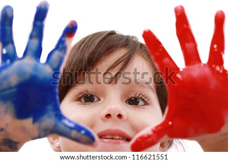 Happy smiling little girl playing with colors - stock photo