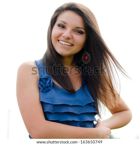 happy smiling & looking at camera young confident woman in blue blouse smiling