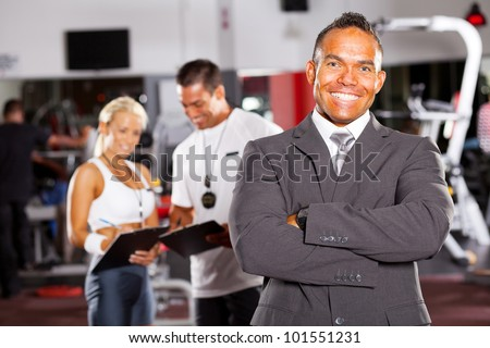 happy smiling male gym manager portrait - stock photo