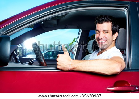 Happy smiling man in new car. Driving. - stock photo