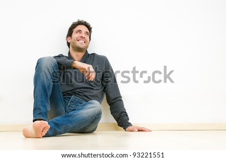 Happy smiling man looking up and dreaming at his future - stock photo