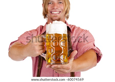 Happy smiling man with leather trousers (lederhose) holds oktoberfest beer stein. Isolated on white background. - stock photo