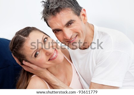 Happy smiling married couple having fun in bed