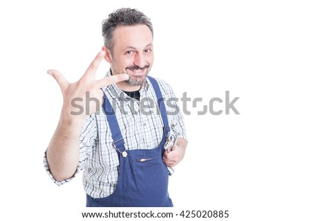 Happy smiling mechanic holding wrench and counting three with copyspace isolated on white background - stock photo