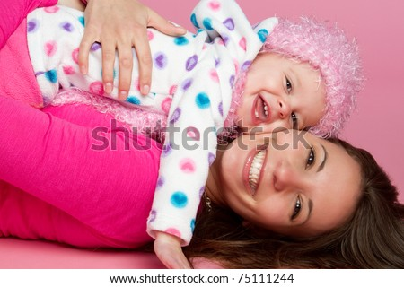 Happy smiling mother and child - stock photo
