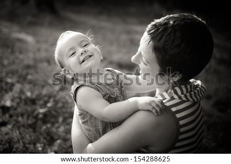 Happy smiling mother and daughter - stock photo