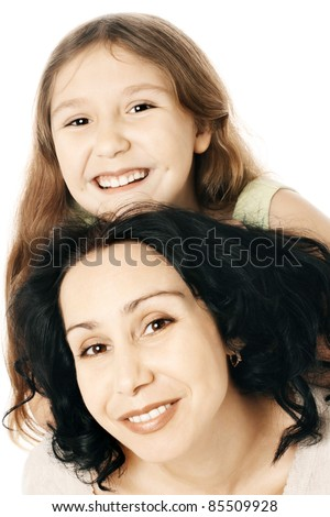 Happy smiling mother and daughter child girl. Family isolated on white - stock photo