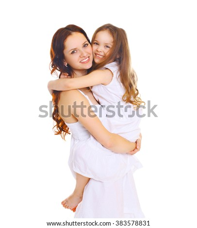 Happy smiling mother hugging little child daughter on white - stock photo
