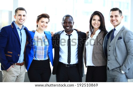 Happy smiling multi ethnic business team in office