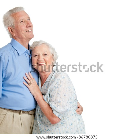 Happy smiling old couple standing together isolated on white background copy space - stock photo