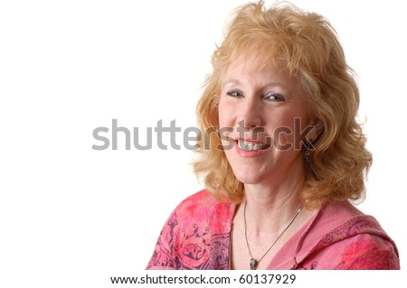 Happy, smiling older woman isolated on white - stock photo
