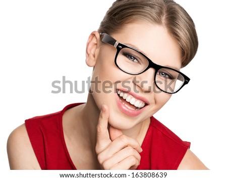 Happy smiling optician woman wearing spectacles, isolated on white background. Portrait of beautiful blond stylish female model in fashionable eyeglasses.  - stock photo
