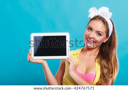 Happy smiling pin up girl holding tablet computer with blank screen copyspace. Retro woman advertising new modern technology. Old vintage fashion. - stock photo