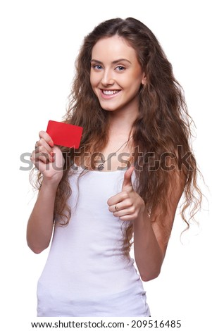 Happy smiling playful woman showing blank credit card and gesturing thumb up, on white background - stock photo