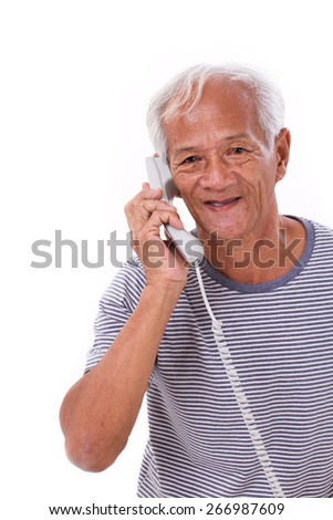 happy, smiling, relaxed old senior man talking via telephone - stock photo