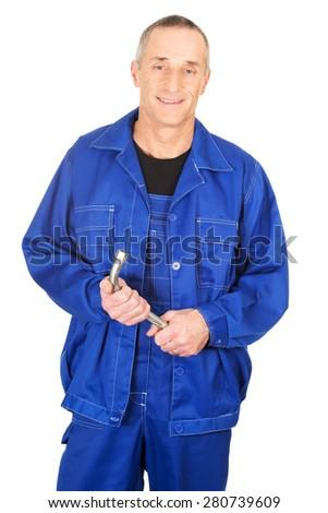 Happy smiling repairman holding wrench. - stock photo