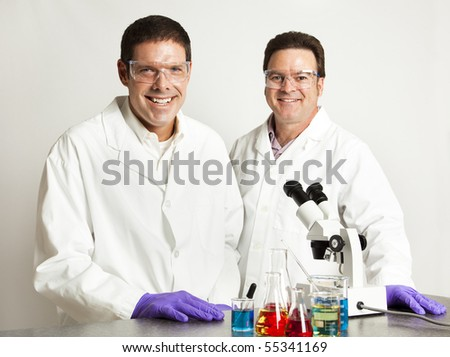 Happy, smiling scientific colleagues in the laboratory. - stock photo