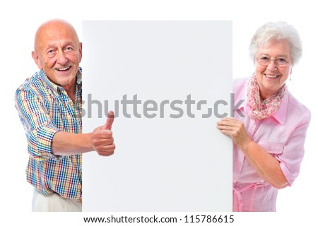 happy smiling senior couple holding a blank board isolated on white - stock photo