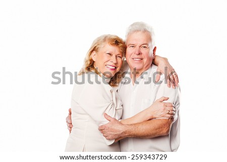 Happy smiling senior couple in love. On white background. - stock photo