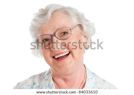 Happy smiling senior lady looking at camera with her glasses isolated on white background - stock photo