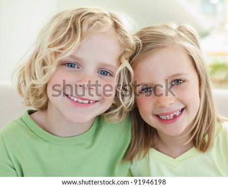 Happy smiling siblings - stock photo