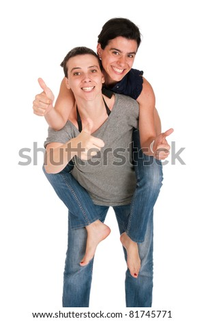 happy smiling sisters showing thumbs up sign while playing together piggyback, isolated on white background - stock photo