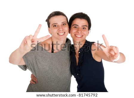 happy smiling sisters showing victory hand sign, isolated on white background - stock photo
