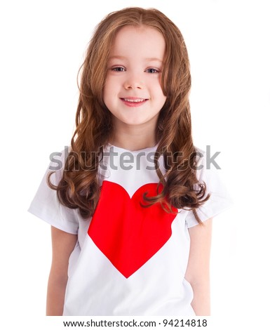 happy smiling six year old girl wearing a  shirt with a big red heart, isolated against white background - stock photo