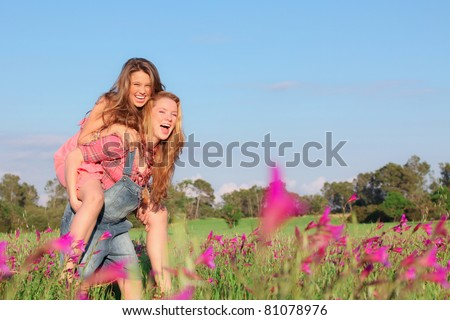 happy smiling spring or summer piggy back teens or teenager kids - stock photo