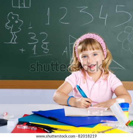 happy smiling student girl at school classroom