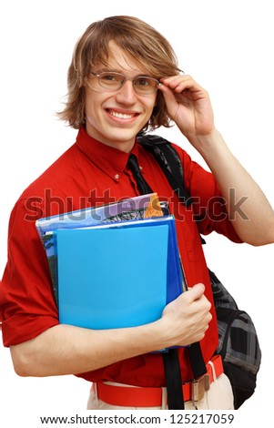 Happy smiling student standing and holding books