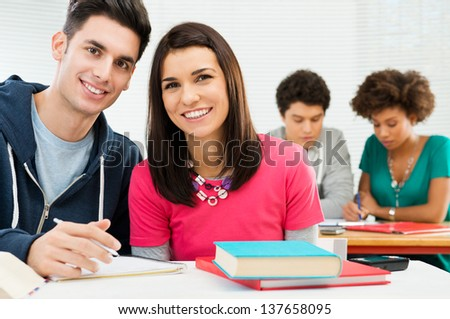 Happy Smiling Students Studying In Classroom