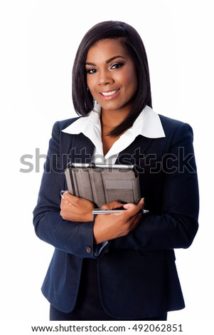 Happy smiling successful business woman standing with tablet and pen in arms, on white.