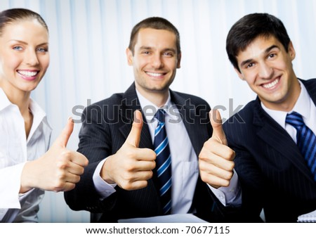 Happy smiling successful gesturing businesspeople at office. Focus on hands. - stock photo