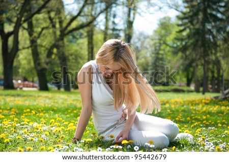 Happy smiling teen girl outdoors - stock photo