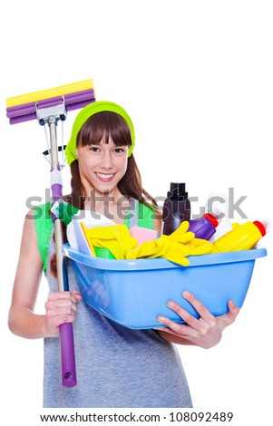 Happy smiling teen holding mop and  basin with chemical detergents - stock photo