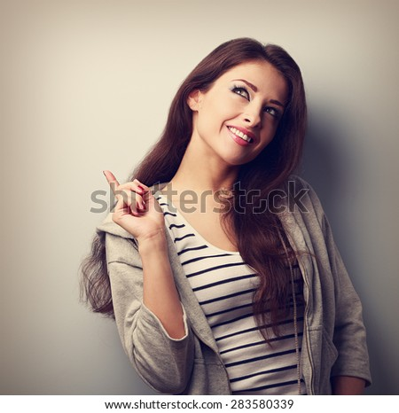 Happy smiling thinking woman have an idea and looking up. Vintage closeup portrait - stock photo