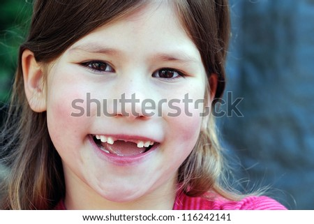 happy smiling toothless little girl - stock photo