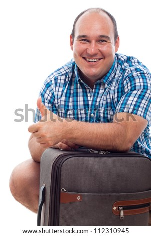 Happy smiling traveller tourist man with luggage, isolated on white background. - stock photo