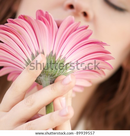 Happy smiling woman at cafe with flower. Dating - stock photo